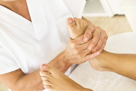 Massages and osteopathy to a woman foot