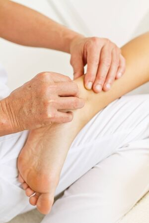 Massages and osteopathy to a woman heel
