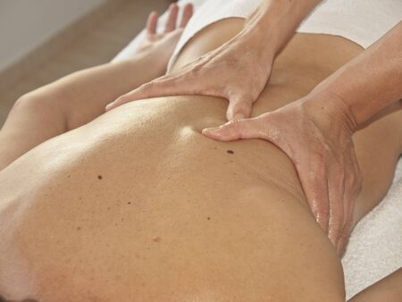 Massages and osteopathy to a woman on her back 写真素材