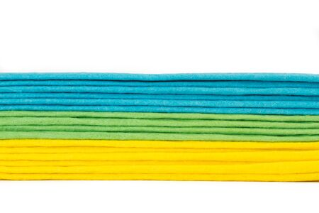 Colored sponge cltohes isolated on a white background