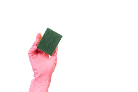 Hand with a pink rubber glove holding a sponge on a white background