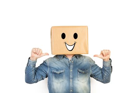 Man with his head in a box and happiness gesture drawn on it and thumbs up