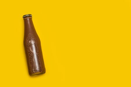 A bottle of chocolate milk on a yellow background with copy space Reklamní fotografie