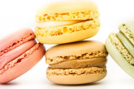 Multicolored macarons isolated on a white background in a close up view