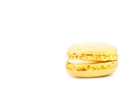 Lemon taste macaron isolated on a white background with copy space Archivio Fotografico