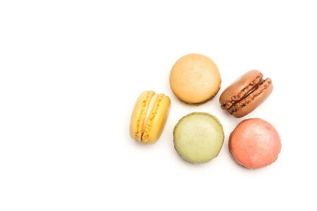 Multicolored macarons isolated on a white background in a top view