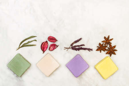 Colored soap bars on a white marble background in a top view 版權商用圖片