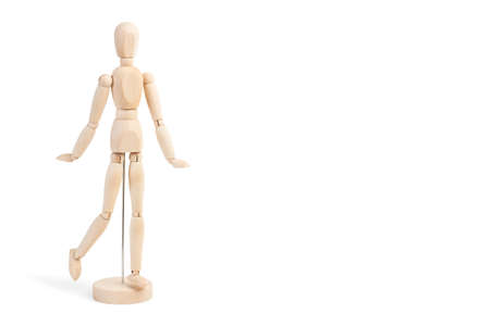 A wooden mannequin toy on a white background with copy space 版權商用圖片