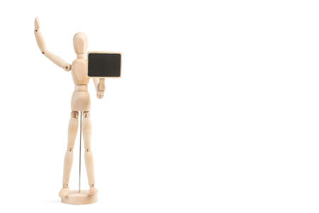 A Wooden mannequin toy holding a small blackboard on a white background with copy space 版權商用圖片