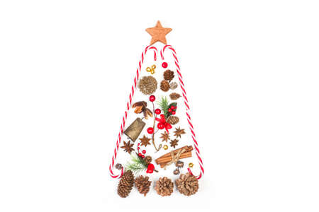 A christmas tree made with christmas ornaments on a white background