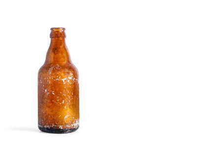 An old empty bottle of beer on a white background with copy space