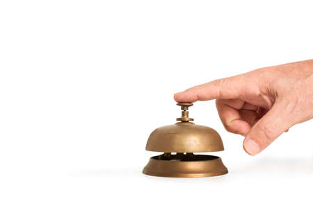 Man hand ringing a reception bell on a white background