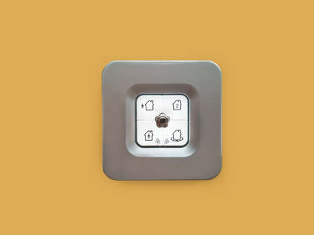 House alarm control on a brown wall