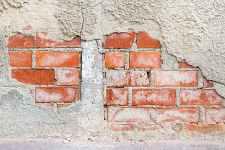A cement and bricks wall in a close up view