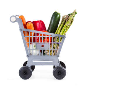 A plastic toy shopping cart with vegetables on a white background