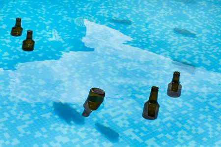 Empty beer bottles inside a swimmming pool