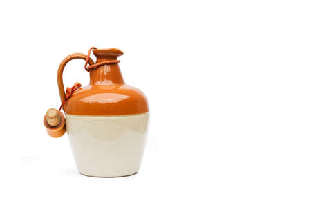 Old brown and white jar on a white background with copy space