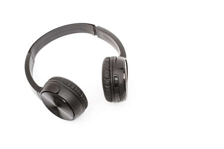 Black headphones on a white background with copy space