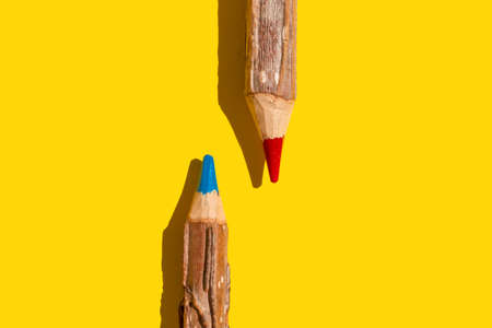Colored pencils on a yellow background with copy space