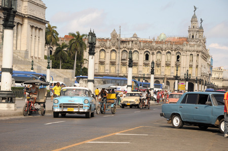 capitolio: old retro american car driving on street in Cuban capitol city Havana Editorial
