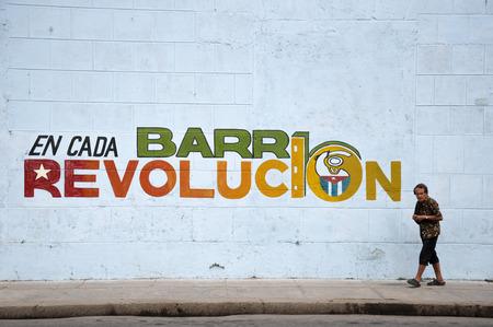 castro: Old Cuban woman walking on street Editorial
