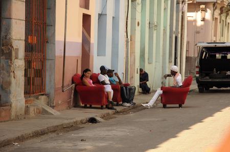 capitolio: Cuban people sitting on street in Old Havana, Cuba