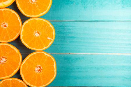 Fresh orange halves on rustic wooden kitchen table