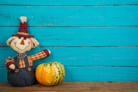Halloween funny  scarecrow on wooden background photo