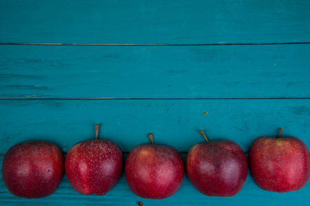 Farm fresh organic red  apples on wooden table in pastel color with copy space in background Stok Fotoğraf