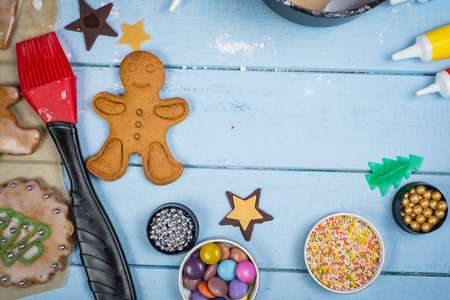 Table view of decorating Christmas gingerbread man cookie photo