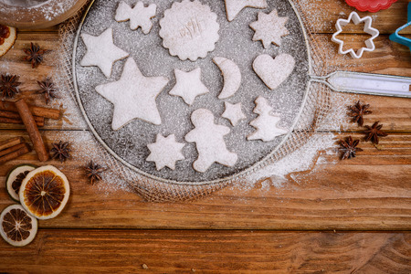 Winter theme cookies on rustic table photo