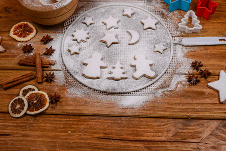 Cookies and winter spices on rustic table photo