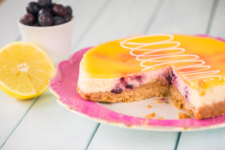 citrous: homemade cheescake on plate on table