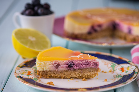 citrous: traditional homemade lemon and blueberry cake on plate
