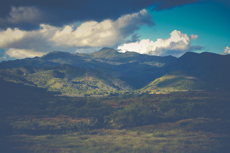 cross processed: Landscape panorama view on mountains with clouds in vintage effect