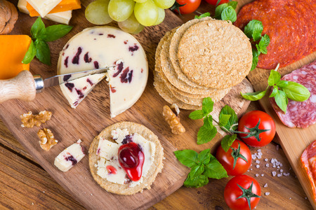 Healthy starters on rustic wooden cheese board photo