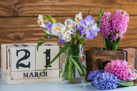 first day: First day of spring vintage callendar and fresh flowers