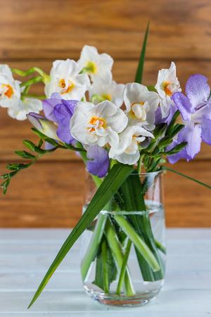 fresh spring daffodil in glass photo