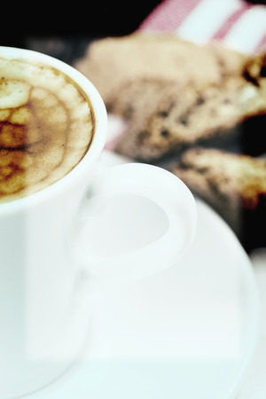 expresso: italian creamy expresso with cantuccini biscuits Stock Photo