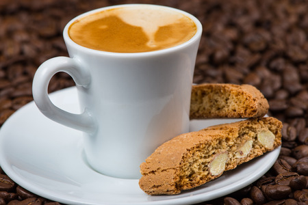 Italian style breakfast, coffee with almond biscuits Imagens