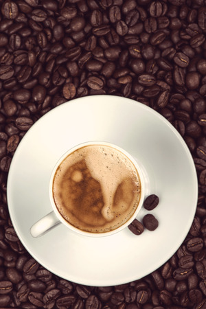expresso: overhead view on cup of expresso coffee  and roasted beans Stock Photo