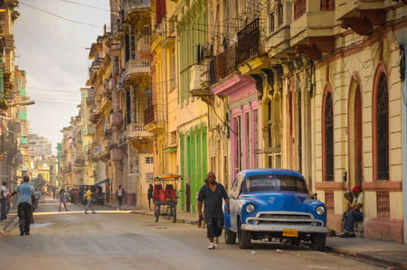 culture: Havana, CUBA - JANUARY 20, 2013: Old classic American car park on street of Havana,CUBA. Old American cars are iconic sight of Cuba street.