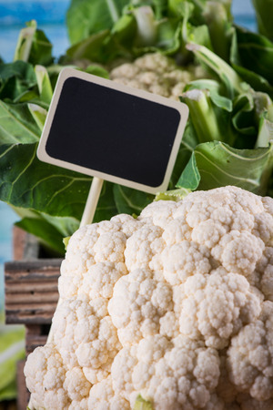 head tag: Fresh organic cauliflower head with copy space price tag