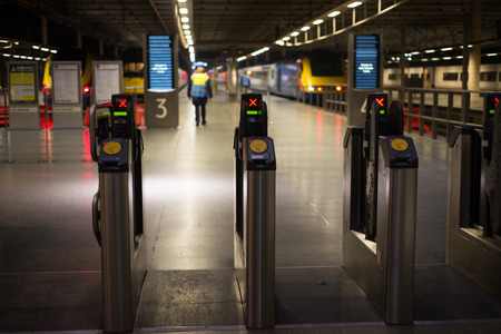 tube station: LONDON, ENGLAND - NOVEMBER 7, 2014  Electronic pass gate on metro tube station in London St Pancras Editorial