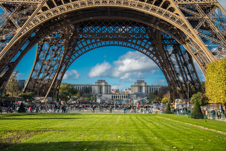 atraction: PARIS, FRANCE - NOVEMBER 9, 2014 People, mainly tourists queuing to get acces to Eiffel Tower , main tourist atraction in Paris, France. Editorial