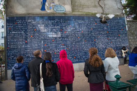 atraction: PARIS, FRANCE -  NOVEMBER 8, 2014 Wall of Love created by Frederic Baron, with I Love You written in more than 300 languages.Famous meting place for lovers especially in Valentine Day.