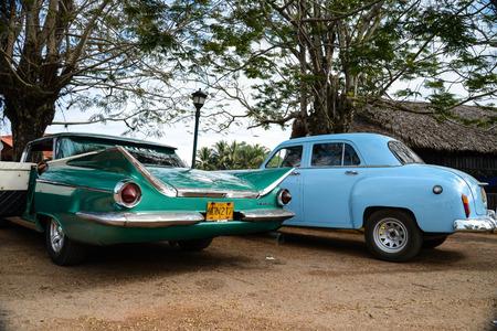 communists: HAVANA, CUBA - DECEMBER 6, 2014 Classic American car park on street in Havana,Cuba.Cuba is known for the beauty of its vintage cars