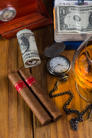 alcochol: Wealthy man desk, cuban cigars dollar notes, vintage watch and alcochol