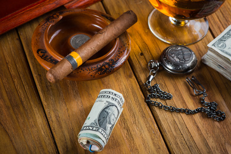 Relaxing cuban cigar after hard day, with glass of Rum photo
