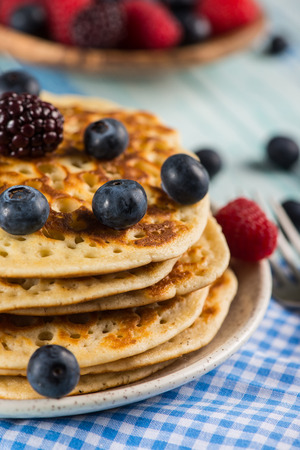 stack of fresh pancakes with fresh fruits photo